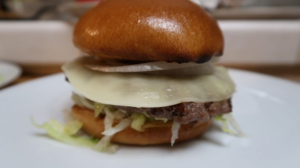 Hamburger with grilled burger and topped with provolone cheese